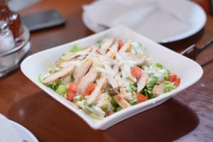 Chicken, veggies, and fruit all go well together in a salad.